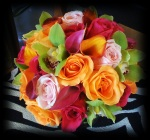 Orange Calla Lilies, Orange and Pink Roses, Green Cymbidium Orchids